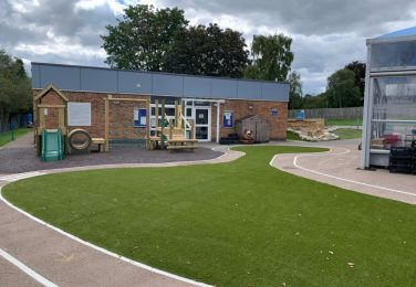 The Lea Primary School and Nursery climbing frame and race track in Early Years playground
