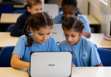 Pupils working together on laptop at The Lea Primary School and Nursery