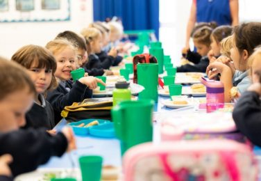 Lunch table with pupils at The Lea Primary School and Nursery